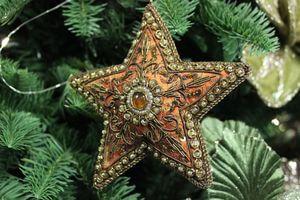 Oranžovo zlatá závesná hviezda orient 10cm